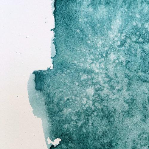 Las texturas generadas al pulverizar el agua sobre la acuarela.